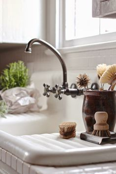 Love the old sink and wall mount faucet and handles.
