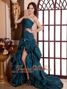 Teal Ruched Bodice and High Slit For Prom Dress With Brush Train    http://www.fashionos.com  The thoroughly modern style of this strapless high-low dress is bound to brighten up your day!Its fits-like-a-glove design is enhanced by a fitted strapless bodice and exquisite ruching accents thoughout the bust. Billowing pick ups round out the look neatly.