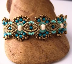 Teal and Khaki Beaded Macrame Bracelet MicroMacrame Flowers. $38.99, via Etsy.