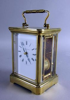 Brass and four glass repeating carriage clock with : Lot 530. I own this one. Purchased it in London 32 years ago!!!!!!!