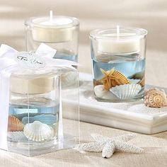 Ideal for a beach wedding or destination wedding reception, ocean seashell gel tea light candle holders make useful decorations and take home favors for your wedding guests. An assortment of seashells are showcased in the ocean-blue gel of the candle holders.