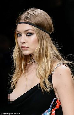 Gigi Hadid is a true professional as she suffers embarrassing nip slip on the runway for Versace | Daily Mail Online