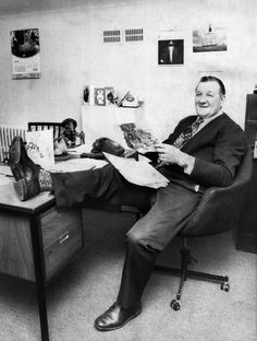 Liverpool manager Bob Paisley looking relaxed with his leg on the desk as he reads greetings card in his office at Anfield. May 1976.