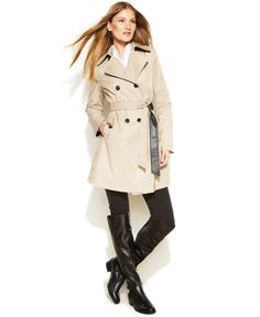 DKNY's classic double-breasted trench coat offers timeless style with a twist, thanks to the addition of edgy faux-leather trim at the belt and behind the collar.