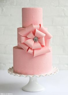 Wow! Really like how pretty and sophisticated this pink wedding cake is #wedding #weddingcake #pink #bow #cake