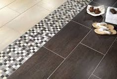 use an accent tile as a transition between wood and tile flooring