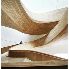 The amazing Harbin Opera House blends nature with topgraphy designed by MAD Architects #harbinoperahouse #design #architecture #MADArchitect #wood #woodwork #staircase #stairs