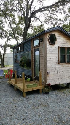 Stephanie's Tiny House on Wheels - The home includes gorgeous built-in window boxes for a fun on-house garden, a skylight that lets you lay out on the roof and stargaze, and a spacious double loft for owner and guests — or a reading nook! : tinyhousetalk