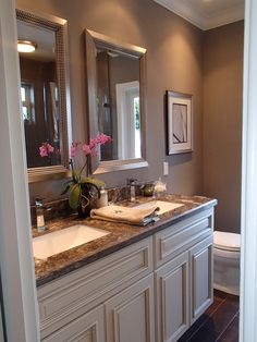 The After: Stunning Master Bath with painted cabinets and porcelain wood tile flooring, far from the pink disaster it started out as