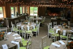 Mid-Summer Lodge Interior with bright green and burlap and white chairs.