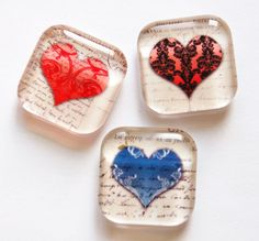 This set of three hearts are sealed behind clear 1 x 1 square glass tiles. Attached to the back of each is a small but very strong 3/8 neodymium