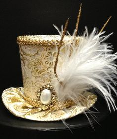 Gold Brocade Mini Top Hat for Dress Up, Birthday, Tea Party or Photo Prop. $35.95, via Etsy.