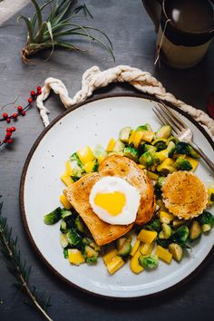 egg-in-a-basket over miso butter brussels sprouts | gluten free recipe via willfrolicforfood.com