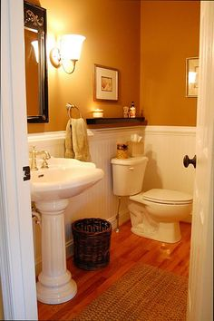 white wainscoting done in bathroom......with brown paint for walls and tiles above shower