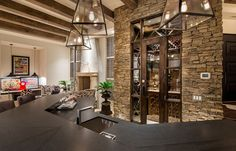 Interior Exquisite Arizona Desert Mountain Retreat With Comforting Views: Awesome Interior Design Of New Building With Inque Wall In Stones Plus Great Ceilling With Wooden Combination Also Three Pendant Lights In Glass Frame Plus One Black Table