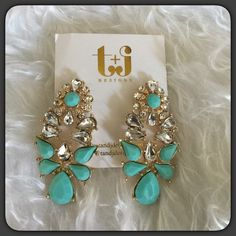 """""""Just In"""" Teal & Rhinestones Earrings Beautiful Teal and Rhinestones Droplet earrings by T&J Designs. 18k gold plated, pretty rhinestones with sparkle. Lead and nickel free. Approximately 2"""" long. Wear from casual to an evening out! You may purchase this listing, if you would like more than one set, I will create a separate bundle listing for you. T&J Designs Jewelry Earrings"""