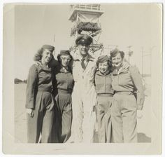 Blossom Ellis with three other flight nurse students and unidentified male officer wearing a jumpsuit. Picture of the five is taken in front of a tower, possibly on a runway, February 2, 1954, 61 years ago today.