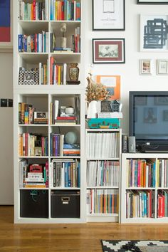 15 Super Smart Ways to Use the IKEA Kallax Bookcase.  Bookcases, including a couple of Kallaxes, cover the walls