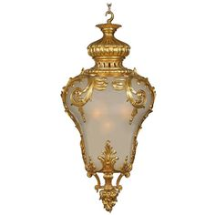 For Sale on - An extraordinary and rare French, century Louis XV style ormolu and frosted glass lantern. The large lantern is centered by an exquisitely chased, Vintage Chandelier, Chandelier Pendant Lights, Modern Chandelier, Chandeliers, Antique Lanterns, Large Lanterns, Antique Furniture Stores, Old Perfume Bottles, Vintage Architecture