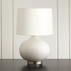 Shop Merie Ivory Table Lamp with Nickel Base.  An ivory crackle glaze lends an ethereal effect to the Merie's hand-fired ceramic body, complemented by a brushed bronze base and off-white linen drum shade.