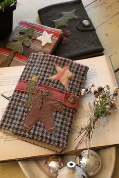 ~cover old books or journals with homespun material, glue or tack on felt cutouts: make a closure with strip of material w/button snap..