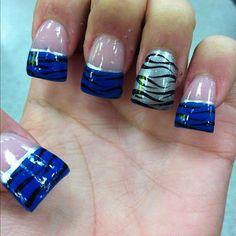 Navy blue, black, and silver zebra nails.