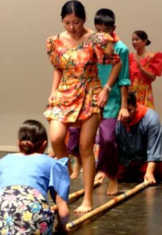 Tinikling, a popular Filipino folkoric dance that requires stamina and agility.
