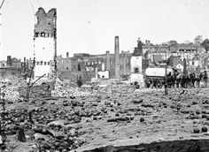 The Civil War, Part 1: The Places - In Focus - The Atlantic Grounds of the destroyed Arsenal with scattered shot and shell in Richmond, Virginia, in 1865. (LOC)