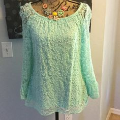 Beautiful lacy boutique top by Yetts Los Angeles Lacy mint colored bell sleeve top. I got this at a boutique in FL. Sleeves are sheer, body is lined. Super soft material. This would be adorable with capris, shorts or even jeans. Yetts Los Angeles Tops Blouses
