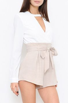 Get two looks in one with this jumpsuit! The white top and complementary beige shorts have a linen feel that makes this piece easy to dress up or down. The waist tie and keyhole neckline are matched with long sleeves to create the perfect silhouette. Closes with a concealed zip in the back. Romper is lined.