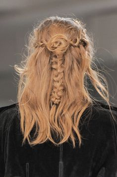"""Get all the compliments with this amazing half-up 'do. Braid 1"""" sections from each side; meet in the center. Swirl hair into rosette and pin. Braid ends down the center.   - Seventeen.com"""