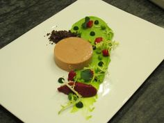 """Foie Gras Torchon-New School: Almond milk gelee, pickled strawberries, strawberry compote, English Pea puree, mint oil, and coffee-chocolate """"dirt."""" Chef Marcus Ware of Aureole."""