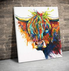 highland cow canvas with big colourful fringe, leaning against wall