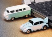 The USB drives are licensed Volkswagen Beetle and Microbus replica with detail features such as transparent windows, rotatable wheels, and illuminating headlights.  The USB flash drive is accurate to the smallest detail exceeding the expectation of worldwide fans. Officially licensed by Volkswagen GmbH.  	 The USB flash drive is cleverly concealed inside the trunk. When the device is plugged into the USB port of a computer, the headlights light up.