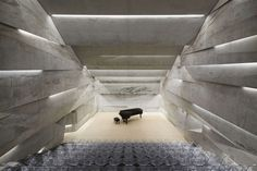 To revitalize the center of Blaibach, Germany, Munich-based Peter Haimerl Architektur has designed the town's concert hall (Konzerthaus Blaibach) as a solitaire of concrete, which emerges from the ground with an inclined orientation.