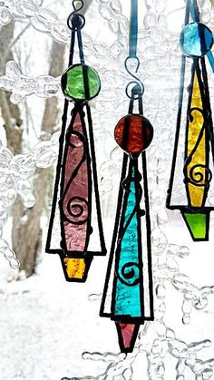 These whimsical Icicle Christmas Trees come in a set of three. For these I used clear frost like glass for the back, I added assorted various colored clear glass to make them 3D and added decorative wire and a glass nugget for the topper. I have added colorful ribbon to hang from. Each