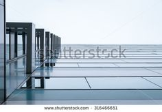 Urban Geometry, looking up to glass building. Modern architecture, glass and steel. . Abstract architectural design. Inspirational, artistic image.Minimal art.