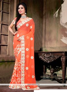Capture the exuberance of womanhood in its full glory that will bring out your fragility and femininity. Women beauty is magnified tenfold in this alluring orange georgette designer saree. This beauti...