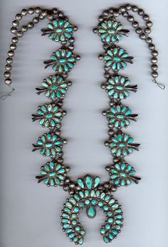 I was actually left one of these by my favorite uncle....vintage zuni squash blossom necklace