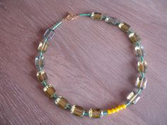 Beautiful necklace in yellow gold and neon !