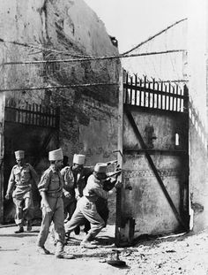 The Campaign in Mandalay February - March 1945: Men of the Madras Sappers stand before the gates of Fort Dufferin after the Japanese had fled.