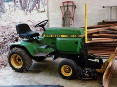 1979 John Deere 314 with hydraulic snow/grader blade. John Deere Garden Tractors, Compact Tractors, Lawn Mower, Outdoor Power Equipment, Blade, Snow, Lawn Edger, Grass Cutter, Garden Tools