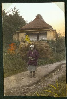 Woman with bundles on her back, Japan.