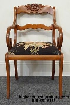 WILLETT Wildwood Cherry Rose Flower Back Duncan Phyfe Arm Chair...My dining room chairs are of this style. I believe the seat cushions have springs in them, atleast they feel like it!