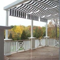 This Shadetree Canopy with striped Sunbrella fabric is installed between the pergola rafters on this tropical hardwood mahogany deck with oversized rail columns and infill insets for accent. The Butler Township deck was featured on a Home a rama home north of Dayton Ohio.