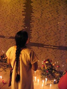 Woman at one of the memorial walls. This one is in San Salvador and lists 30,000 names.