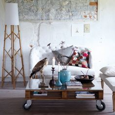 Sanded and properly treated with varnish, recycled pallets can even become a focal part in a room. There is a natural gap in their design, that can be perfectly utilised as a magazine shelf.