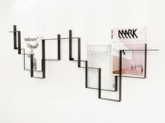 Magazine rack by frederik roije - Love that it is functional art!