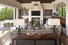 Den opens to the Pacific Ocean - mediterranean - family room - los angeles - Dayna Katlin Interiors