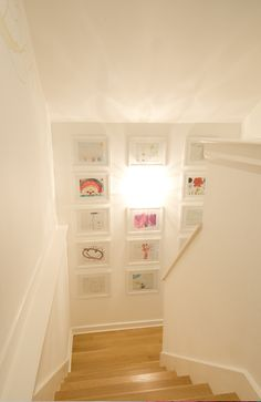 white mats and frames  Love the idea of framing children's art work to decorate the home.